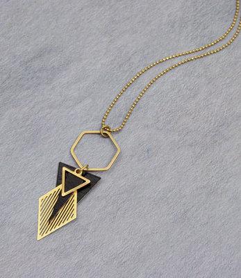 Lange zwart goud art deco hexagon halssnoer